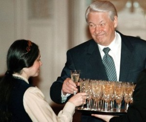 File photo of Russian President Boris Yeltsin and an unidentified teacher taking glasses of champagne during an awards ceremony in the Kremlin